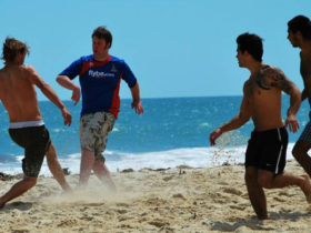 backpackers-beach-footy